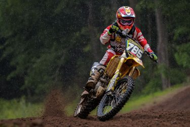 Evan Geller coming out of the valley in the rain Sunday at Martin MX Park.