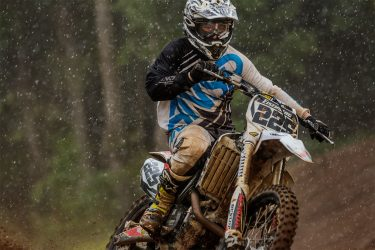 Mike Eisenberg on the throttle during the down pour on 6/7/2015l at Martin MX Park.