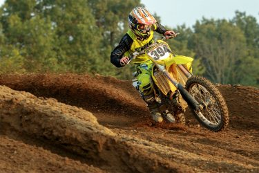 Mike Tomanek hard on the throttle as the sun sets at Martin MX Park