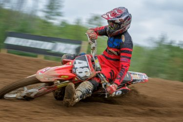 Brent Stevens #48 throttles through the corner at Martin MX Park
