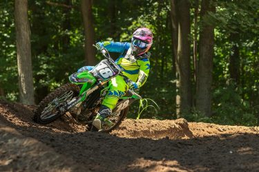 Jaimee Busscher cornering at Martin MX Park through the deep shadows